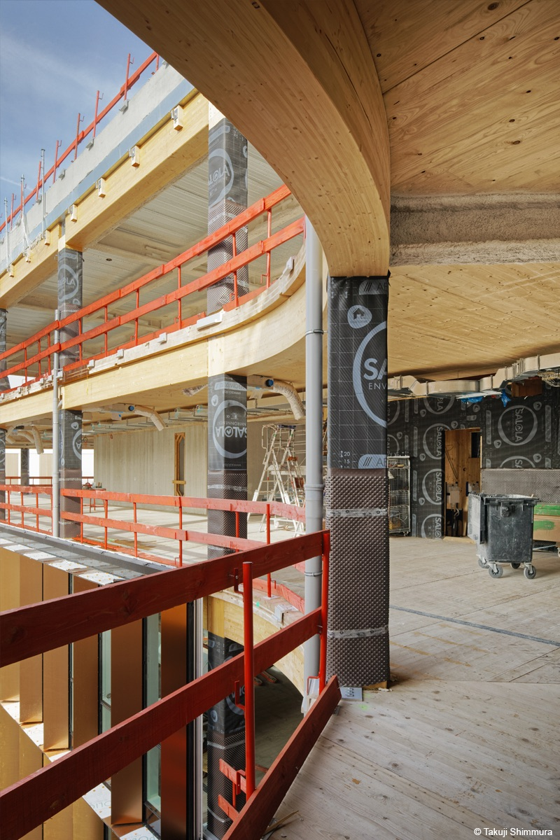 Curve Immeuble de bureaux en bois lamellé et béton bois lamellé cintré
