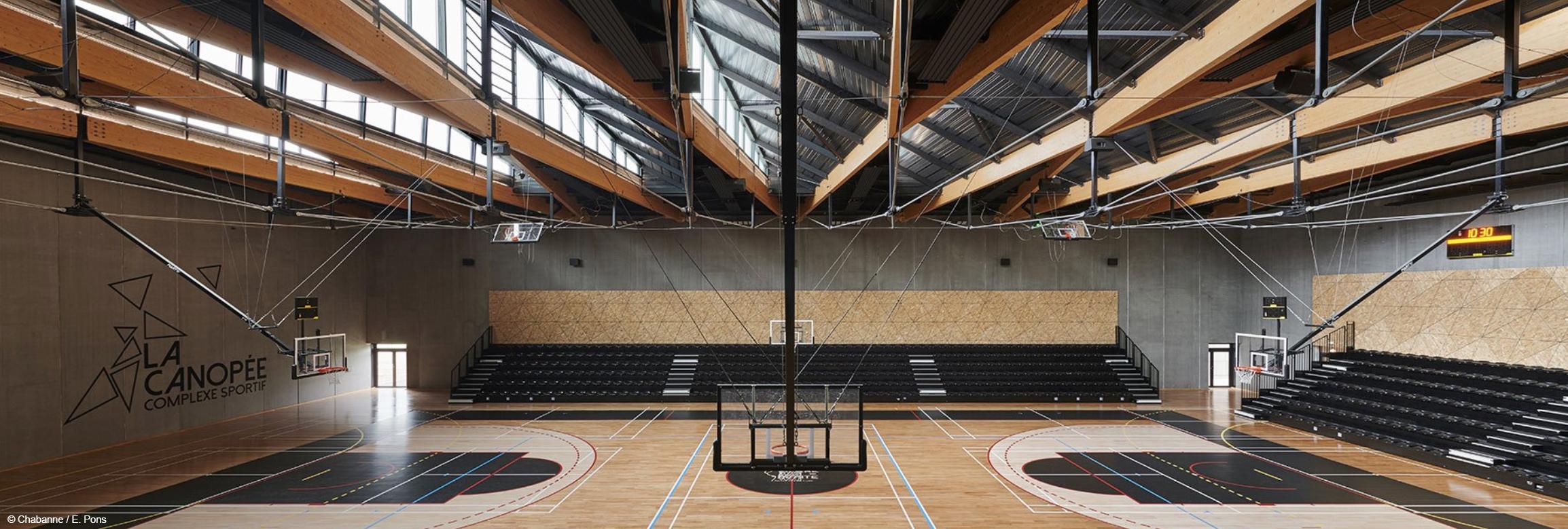 bois lamellé construction bois ouvrage sportif bâtiment BEPOS Biosourcé